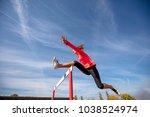 female athlete jumping above... | Shutterstock . vector #1038524974