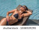 beautiful woman enjoying summer ... | Shutterstock . vector #1038539290