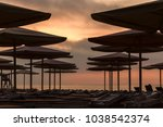 silhuettes of beach loungers... | Shutterstock . vector #1038542374