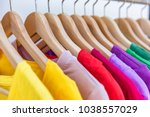 fashion clothes hanging on... | Shutterstock . vector #1038557029
