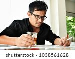 alcohol addicted businessman is ... | Shutterstock . vector #1038561628