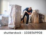 black man moving furniture   Shutterstock . vector #1038569908