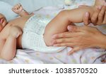 close up of mother hands put on ... | Shutterstock . vector #1038570520