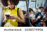 young woman using a smartphone... | Shutterstock . vector #1038574906