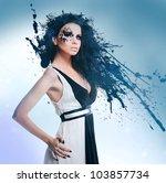Black splatter woman in dress - stock photo