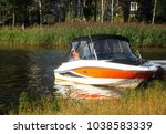 boat on the river in the forest - stock photo
