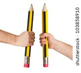 Small photo of Hands holding long pencils with erasure isolated on white background