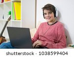 young teenager with laptop at... | Shutterstock . vector #1038599404