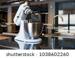 a beautiful white mixer with a... | Shutterstock . vector #1038602260