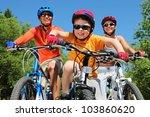 Portrait Of Happy Boy Riding...
