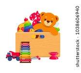 wooden box full of kids toys.... | Shutterstock .eps vector #1038606940