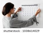 woman checking the calendar | Shutterstock . vector #1038614029