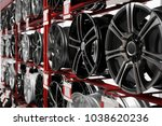 Stand with alloy wheels in modern tire store - stock photo