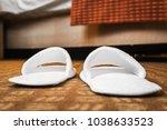 white slippers in the hotel... | Shutterstock . vector #1038633523