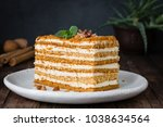 slice of layered honey cake.... | Shutterstock . vector #1038634564