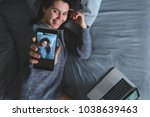 young woman take selfie in bed... | Shutterstock . vector #1038639463