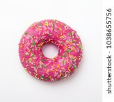 purple donut in glaze on a... | Shutterstock . vector #1038655756