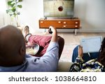 couple watching tv at home... | Shutterstock . vector #1038664810