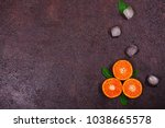 ripe mandarines with leaves... | Shutterstock . vector #1038665578
