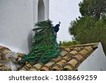 peacock on the roof of the... | Shutterstock . vector #1038669259
