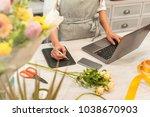 female florist receiving an... | Shutterstock . vector #1038670903