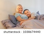 senior couple in bed together | Shutterstock . vector #1038674440