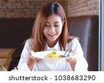 woman enjoy her spaghetti in... | Shutterstock . vector #1038683290