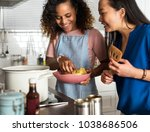 diverse women cooking in the... | Shutterstock . vector #1038686506