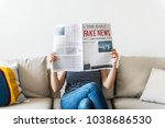 woman reading newspaper | Shutterstock . vector #1038686530