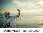 alone traveler holding a... | Shutterstock . vector #1038699850