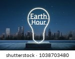 Small photo of Earth hour text inside of lights bulb. Earth Hour Concept