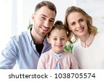 adorable family with daughter... | Shutterstock . vector #1038705574
