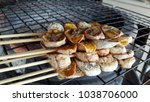 roasted banana on grill | Shutterstock . vector #1038706000