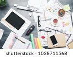 top view of creative messy desk ...   Shutterstock . vector #1038711568