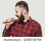 young man singing with a... | Shutterstock . vector #1038718744