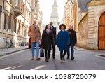 group of mature friends walking ... | Shutterstock . vector #1038720079