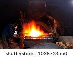 the workshop welder cuts metal  ... | Shutterstock . vector #1038723550