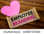 Small photo of Writing text showing Employer Branding. Business concept for Brand Building written on sticky note paper, wooden background. With pink heart meaning love adoration.