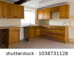 an empty kitchen in a vacant... | Shutterstock . vector #1038731128