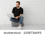 young man using laptop indoors | Shutterstock . vector #1038736693