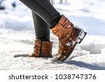 women's boots in snow  brown... | Shutterstock . vector #1038747376
