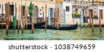 gondolas and wooden piles on... | Shutterstock . vector #1038749659