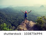 successful young woman hiker... | Shutterstock . vector #1038756994