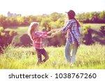 sister girls having fun in the... | Shutterstock . vector #1038767260