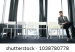 young man waiting for job... | Shutterstock . vector #1038780778