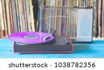 vintage turntable with purple...   Shutterstock . vector #1038782356