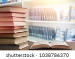stack books in library | Shutterstock . vector #1038786370