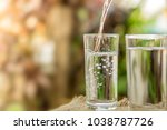 pouring fresh water on drinking ...   Shutterstock . vector #1038787726