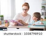 young boy doing homework during ... | Shutterstock . vector #1038798910
