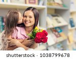 happy child daughter and mother | Shutterstock . vector #1038799678